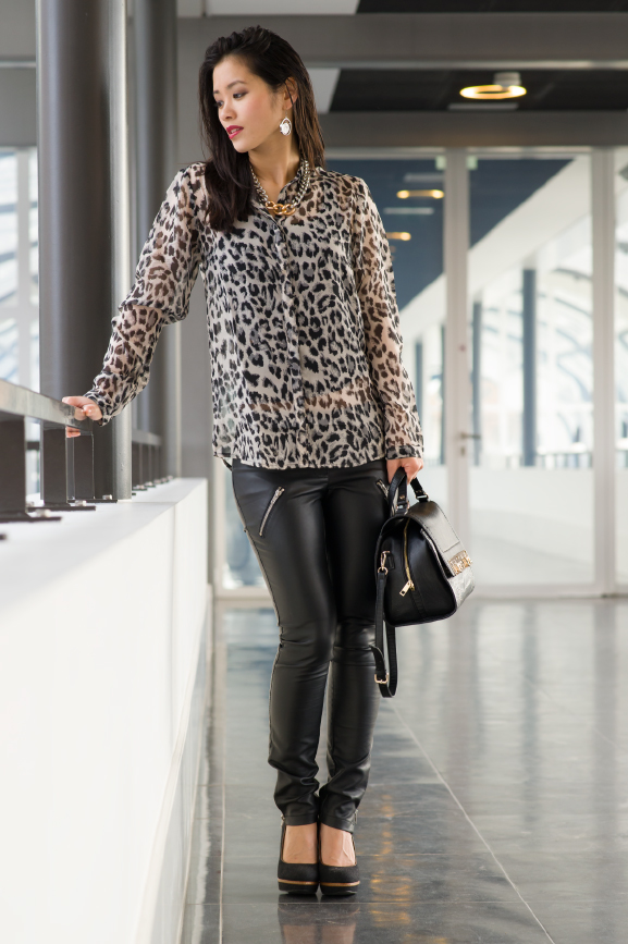 My-Huong-black-chique Outfit: Leather pants vs. Animal print top