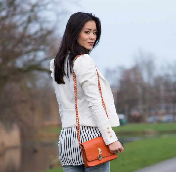 white blazer blouse orange clutch tov essentils