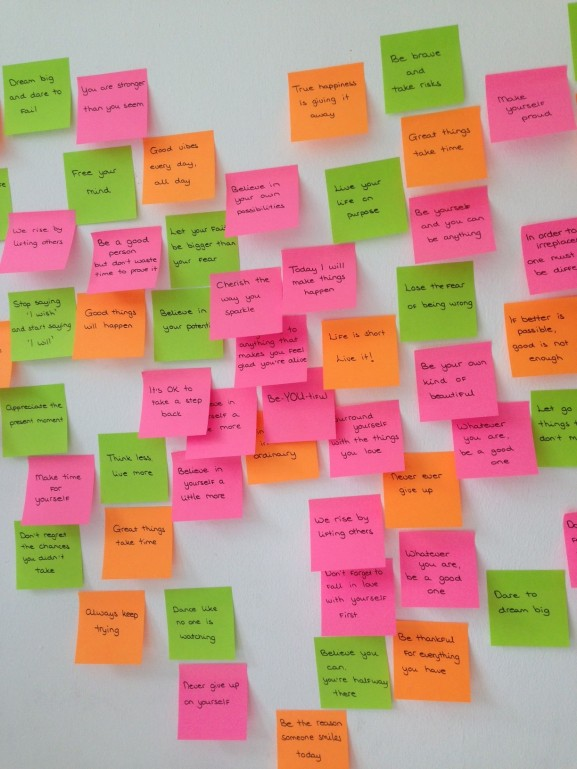 Wall with quotes dreams on postits